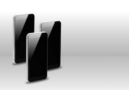 three smartphones over gray background  Stock Photo - 15794712