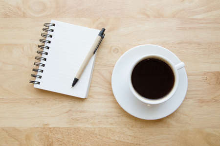 blank note: Blank note book with Black coffee on wood table.