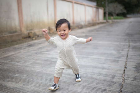 Little baby boy walking along the street. Stock Photo
