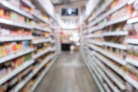 Defocused of shelf, display in supermarket for background.