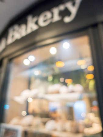 Blurred bakery shop, vertical background.