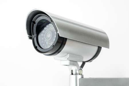 CCTV camera isolated on white background. Stock Photo