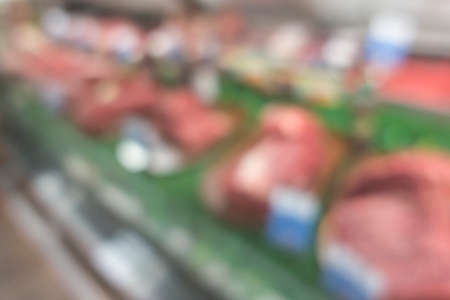 Blurred meat shop for background.