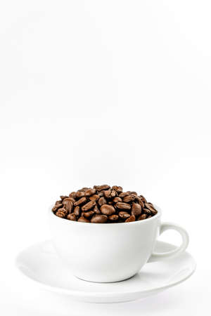 Coffee beans in cup isolated on white background. Foto de archivo