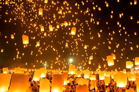 People releasing paper Yee-Peng flying lantern in Kra thong festival, Chiang Mai, Thailand.