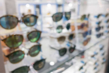 Blurred Sunglasses shop for background.