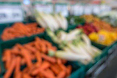 Defocused of vegetables and fruits in supermarket for background.