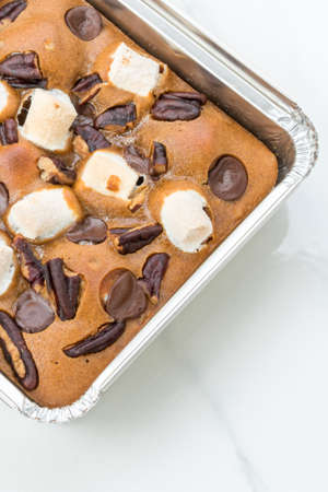 Chocolate Brownies on white marble background. Stock Photo