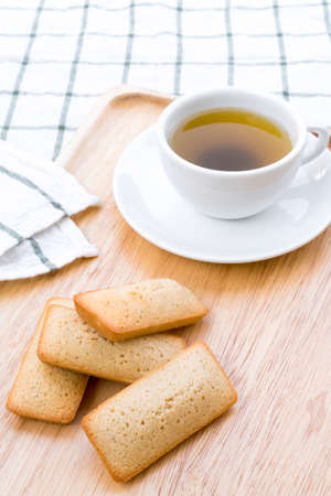 Financier French cakes and tea.