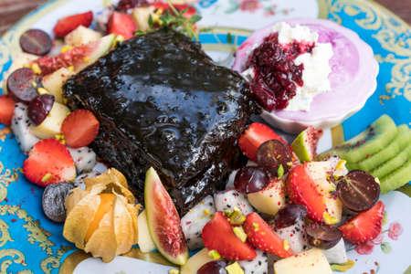Brownie cake with fruit salad. Stock Photo