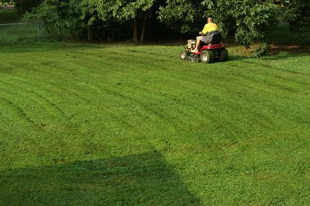 Yardwork Mowing the lawn Stock Photo