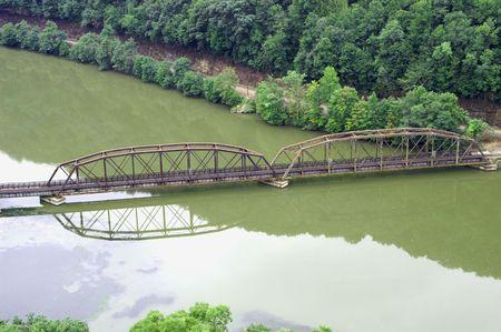 Old bridge across the river Stock Photo