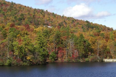 A scenic view of colorful trees and a lake Stock Photo