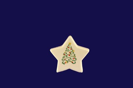 A white star  decoration on a blue background