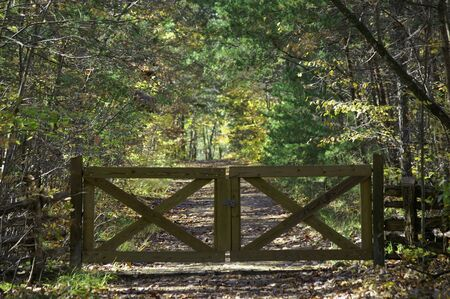 A wooden gate on the path