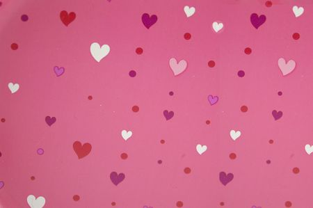 Multicolored hearts on pink background