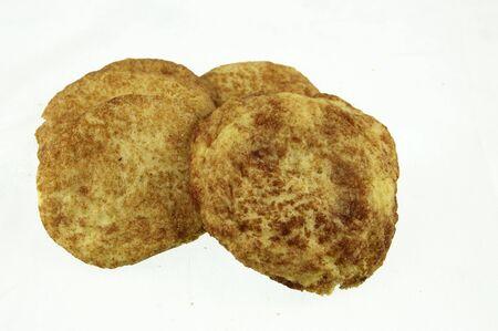 Four sugar cinnamon cookies on white Stock Photo