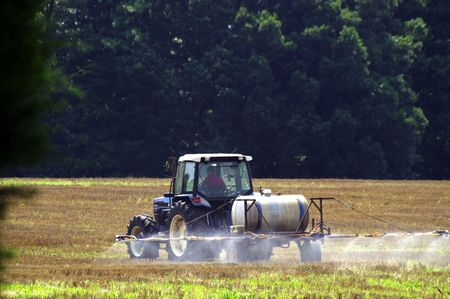 A farmer prepping his field for planting