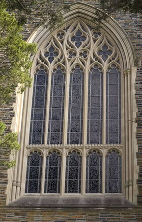 An image of an ornate window on a chapel. Stock Photo