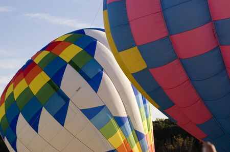 An image of hot air balloons getting ready to acsend.