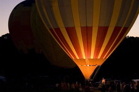 An image of a single balloon glowing at night. Stock Photo
