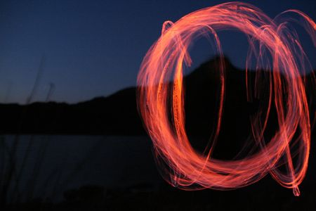 snowdonia: Fire poi beside a lake in Snowdonia, Wales Stock Photo