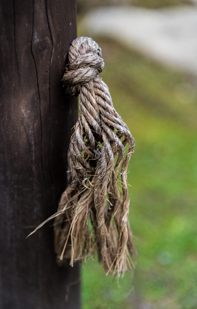 wooden post: A rope knot through a wooden post