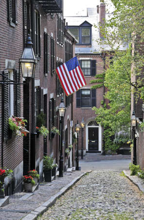 displayed: An American flag displayed on Acorn Street in Boston, Massachusetts