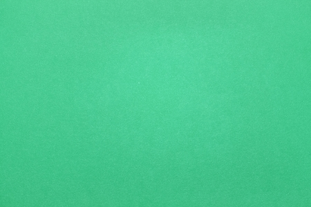 materia: Smooth green paper texture with lots of little flecks and speckles. Stock Photo
