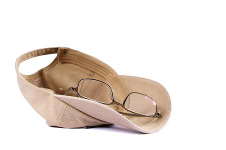 khaki: khaki baseball cap and glasses on white