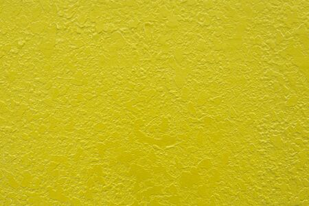 stucco facade: lemon yellow  stucco plaster rendered wall texture background