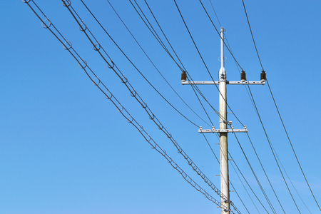 power pole: electric power pole and lines against a blue sky background Stock Photo