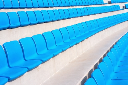 rows of empty blue stadium seats Imagens