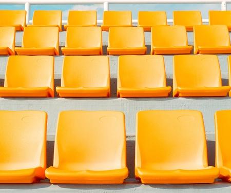 empty yellow stadium seats