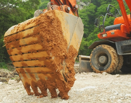 muddy backhoe digger scoop