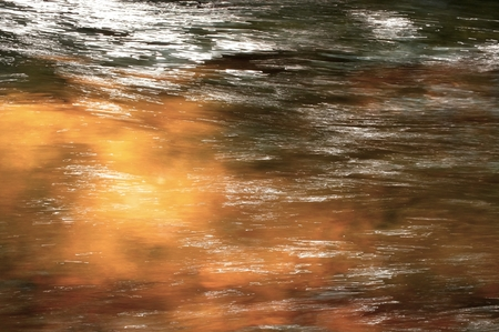 abstract moving water and light honey brown color background Imagens