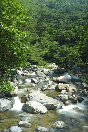river flowing through large stone boulders south korea