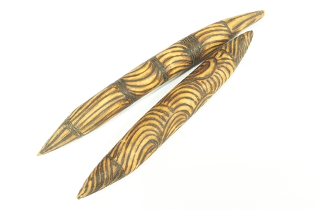 Australian Aboriginal wooden clap sticks isolated on white