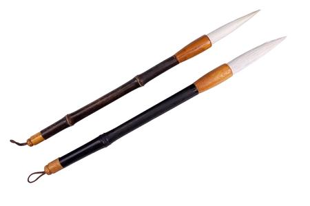 bamboo calligraphy brushes isolated on white Imagens