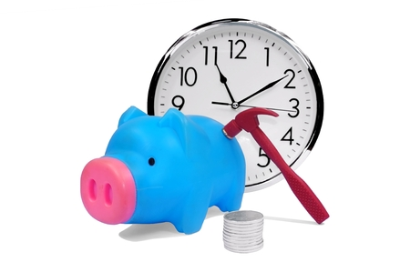 plastic piggy bank with stack of coins clock and hammer