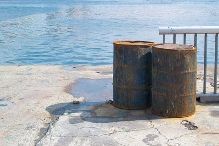 metal industrial drums on river bank
