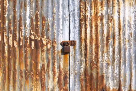 rusty old corrugated iron doors with padlock