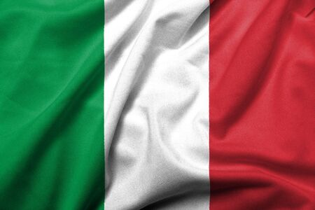 Realistic 3D flag of Italy with satin fabric texture. Standard-Bild