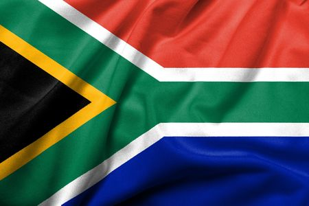 Realistic 3D flag of South Africa with satin fabric texture. Standard-Bild