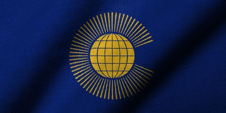 Realistic 3D flag of Commonwealth of Nations with fabric texture waving.