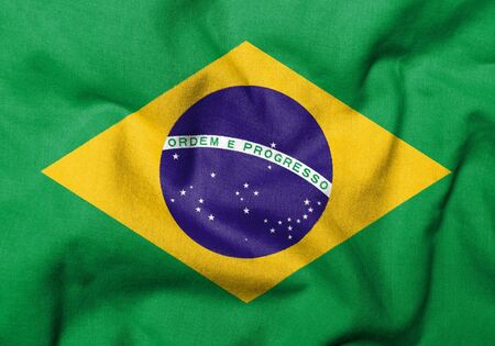Realistic 3D flag of Brazil with fabric texture. Stock Photo