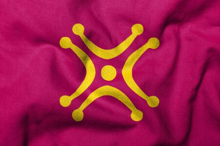 cantabrian: Realistic 3D flag of Cantabria with Labaron symbol and fabric texture. Stock Photo