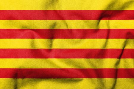 Realistic 3D flag of Catalonia with fabric texture.