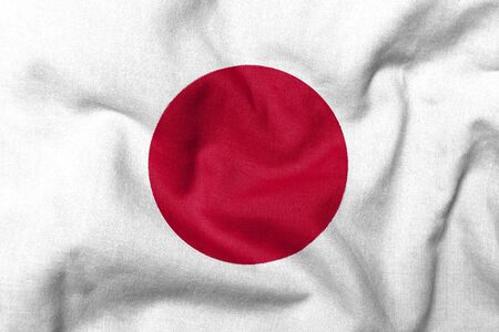 Realistic 3D flag of Japan with fabric texture. Standard-Bild