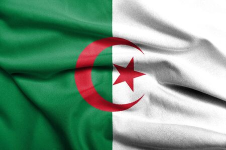 Realistic 3D flag of Algeria with satin fabric texture. Standard-Bild
